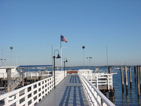 Sailing - Long Dock With American Flag at the End